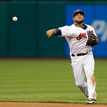 Cleveland Indians shortstop Mike Aviles fires to first but Detroit Tigers' Brayan Pena reaches on an infield single in the second inning of a baseball game Monday, July 8, 2013, in Cleveland …