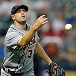 Detroit Tigers starting pitcher Max Scherzer tosses to first to get Cleveland Indians' Mike Aviles on a ground out to end the third inning of a baseball game Monday, July 8, 2013, in Clevela …
