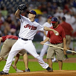 Cleveland Indians starting pitcher Scott Kazmir warms up in the top of the fifth as the grounds grew works on the mound in a baseball game against the Detroit Tigers Monday, July 8, 2013, in …