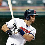 Cleveland Indians' Lonnie Chisenhall singles off Detroit Tigers starting pitcher Max Scherzer to drive in two runs in the second inning of a baseball game Monday, July 8, 2013, in Cleveland. …