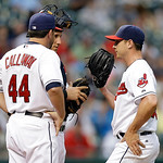 Cleveland Indians pitching coach Mickey Callaway (44) and catcher Yan Gomes meet on the mound with starting pitcher Scott Kazmir, right, in the second inning of a baseball game against the D …
