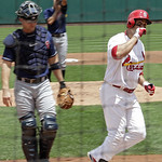 St. Louis Cardinals' Carlos Beltran (3) celebrates as he crosses home plate, as Cleveland Indians starting pitcher Ubaldo Jimenez, rear, and catcher Lou Marson watch, on a solo home run in t …