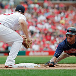 Cleveland Indians' Michael Brantley dives back to first as St. Louis Cardinals first baseman Matt Adams just misses with the tag in the sixth inning of a baseball game, Sunday, June 10, 2012 …