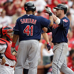 Cleveland Indians' Jason Kipnis, right, celebrates with Carlos Santana, as St. Louis Cardinals catcher Yadier Molina looks away, after hitting a three-run home run in the ninth inning of a b …