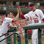 St. Louis Cardinals starting pitcher Joe Kelly is congratulated by Matt Carpenter as he leaves baseball game in the sixth inning against the Cleveland Indians, Sunday, June 10, 2012 in St. L …