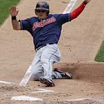 Cleveland Indians' Shin-Soo Choo scores from third on a sacrifice fly by Carlos Santana in the third inning of a baseball game against the St. Louis Cardinals, Sunday, June 10, 2012 in St. L …