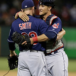Cleveland Indians closer Joe Smith (38) celebrates with catcher Yan Gomes after the final out of the baseball game against the Texas Rangers Tuesday, June 11, 2013, in Arlington, Texas.  The …