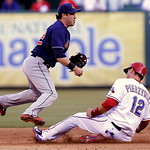 Cleveland Indians second baseman Jason Kipnis (22) jumps as Texas Rangers A.J. Pierzynski (12) slides into second base on the double play during the third inning of a baseball game Tuesday,  …