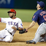 Texas Rangers Leury Garcia, left, is tagged for the double play caught trying to advance to third base on the fly out against Cleveland Indians third baseman Mark Reynolds (12) during the si …