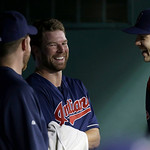 Cleveland Indians starting pitcher Corey Kluber smiles in the dugout after finishing out the eighth inning of a baseball game against the Texas Rangers Tuesday, June 11, 2013, in Arlington,  …
