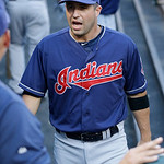 Cleveland Indians John McDonald talks in the dugout during the baseball game against the Texas Rangers Tuesday, June 11, 2013, in Arlington, Texas.  McDonald has rejoined the Cleveland India …