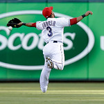 Texas Rangers shortstop Leury Garcia (3) can't reach a ball hit by Cleveland Indians Mike Aviles,  allowing a single, during the third inning of a baseball game Tuesday, June 11, 2013, in Ar …