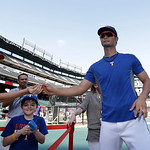 Texas Rangers pitcher Yu Darvish of Japan hands a pen back to a fan after signing an autograph during batting practice before a baseball game against the Cleveland Indians Wednesday, June 12 …