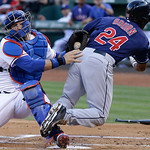 Texas Rangers catcher A.J. Pierzynski (12) tags Cleveland Indians  Michael Bourn (24) out at home plate during the first inning of a baseball game Wednesday, June 12, 2013, in Arlington, Tex …