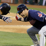 Cleveland Indians' Jason Kipnis, right, celebrates his solo home run with teammate Nick Swisher, left, during the fifth inning of a baseball game against the Texas Rangers, Wednesday, June 1 …