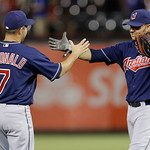 Cleveland Indians John McDonald (7) and teammate Nick Swisher celebrate winning the baseball game against the the Texas Rangers Wednesday, June 12, 2013, in Arlington, Texas. (AP Photo/LM Ot …