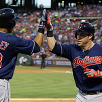 Cleveland Indians 'Jason Kipnis, right, celebrates his solo home run with teammate Michael Brantley (23) during the fifth inning of a baseball game against the Texas Rangers, Wednesday, June …