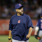 Cleveland Indians manager Terry Francona yells toward home plate while walking back to the dugout from the mound during the seventh first inning of a baseball game against the Texas Rangers, …