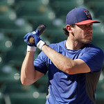 Texas Rangers Texas Rangers Ian Kinsler (5) smiles as he takes batting practice before a baseball game against the Cleveland Indians Wednesday, June 12, 2013, in Arlington, Texas.  (AP Photo …