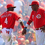 Cincinnati Reds manager Dusty Baker (12) congratulates second baseman Brandon Phillips (4) after they defeated the Cleveland Indians 12-5 in a baseball game on Thursday, June 14, 2012, in Ci …
