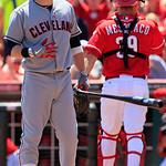 Cleveland Indians' Jason Kipnis, left, tosses his bat towards the dugout after striking out with the bases loaded in the sixth inning of a baseball game against the Cincinnati Reds, Thursday …
