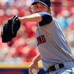 Cleveland Indians starting pitcher Josh Tomlin throws against the Cincinnati Reds in the first inning of a baseball game, Thursday, June 14, 2012 in Cincinnati. (AP Photo/Al Behrman)