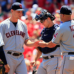 Cleveland Indians relief pitcher Scott Barnes, center left, is taken out of the game by manager Manny Acta (11) as catcher Lou Marson looks on in the fifth inning of a baseball game against  …
