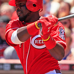 Cincinnati Reds' Brandon Phillips hits a single to drive in a run in the fifth inning of a baseball game against the Cleveland Indians, Thursday, June 14, 2012 in Cincinnati. Phillips had th …