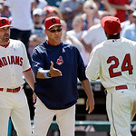 Cleveland Indians manager Terry Francona, center, and pitching coach Mickey Callaway, left, greet center fielder Michael Bourn (24) after a 2-0 win over the Washington Nationals in a basebal …