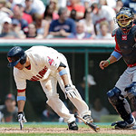 Cleveland Indians' John McDonald spins away from an inside pitch as Washington Nationals catcher Jhonatan Solano makes the catch for ball four in a baseball game against the Washington Natio …