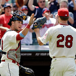 Cleveland Indians catcher Yan Gomes, left, greets starting pitcher Corey Kluber (28) after Kluber got out of a bases-loaded jam against the Washington Nationals in the seventh inning of a ba …
