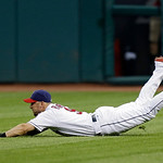 Cleveland Indians right fielder Ryan Raburn dives but can't catch a double by Kansas City Royals' David Lough in the seventh inning of a baseball game Monday, June 17, 2013, in Cleveland. Th …