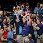 Fans reach for a foul batt off the bat of Kansas City Royals' Salvador Perez in the sixth inning of a baseball game against the Cleveland Indians Monday, June 17, 2013, in Cleveland. (AP Pho …