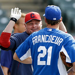 Cleveland Indians' Jason Giambi jokes with Kansas City Royals' Jeff Francoeur (21) before a baseball game Monday, June 17, 2013, in Cleveland. (AP Photo/Mark Duncan)