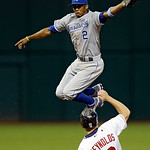 Kansas City Royals shortstop Alcides Escobar (2) leaps for a high throw as Cleveland Indians' Mark Reynolds (12) steals second base in the eighth inning of a baseball game, Monday, June 17,  …