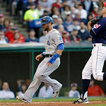 Cleveland Indians' Mike Aviles (4) scores from third on a wild pitch by Cleveland Indians starting pitcher Ubaldo Jimenez, right, in the third inning of a baseball game Tuesday, June 18, 201 …