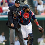 Cleveland Indians catcher Carlos Santana chases down a wild pitch from starting pitcher Ubaldo Jimenez in the third inning of a baseball game against the Kansas City Royals Tuesday, June 18, …