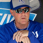 Kansas City Royals manager Ned Yost watches the Cleveland Indians take batting practice from the visitor's dugout before a baseball game Tuesday, June 18, 2013, in Cleveland. (AP Photo/Mark  …