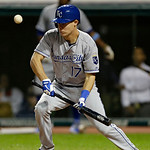 Kansas City Royals' Chris Getz fouls off a bunt attempt in the ninth inning of a baseball game against the Cleveland Indians Tuesday, June 18, 2013, in Cleveland. (AP Photo/Mark Duncan)
