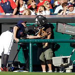 Cleveland Indians first baseman Mark Reynolds leans into the camera pit but can't reach a pop[ foul by Kansas City Royals' Chris Getz in the second inning of a baseball game Tuesday, June 18 …
