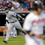 Kansas City Royals third baseman Mike Moustakas holds his throw after fielding a bunt by Cleveland Indians' Jason Kipnis in the sixth inning of a baseball game on Wednesday, June 19, 2013, i …