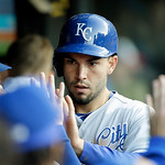 Kansas City Royals' Eric Hosmer is congratulated in the dugout after scoring on a single by David Lough in the fifth inning of a baseball game against the Cleveland Indians Wednesday, June 1 …