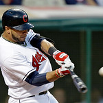 Cleveland Indians' Mike Aviles singles off Kansas City Royals starting pitcher Luis Mendoza to drive in a run in the sixth inning of a baseball game on Wednesday, June 19, 2013, in Cleveland …