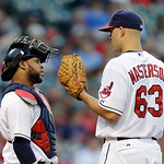 Cleveland Indians catcher Carlos Santana confers with starting pitcher Justin Masterson in the fourth inning of a  baseball game Wednesday, June 19, 2013, in Cleveland. (AP Photo/Mark Duncan …