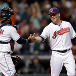 Cleveland Indians relief pitcher Joe Smith, right, shakes hands with catcher Carlos Santana after a 6-3 win over the Kansas City Royals in a baseball game on Wednesday, June 19, 2013, in Cle …