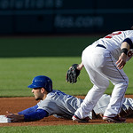 Kansas City Royals' Eric Hosmer steals second base as Cleveland Indians second baseman Jason Kipnis takes the throw in the first inning of a baseball game Wednesday, June 19, 2013, in Clevel …