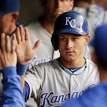 Kansas City Royals' David Lough is greeted in the dugout after scoring on a single by Elliot Johnson in the fourth inning of a baseball game against the Cleveland Indians, Wednesday, June 19 …