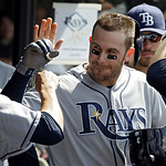 Tampa Bay Rays' Evan Longoria is greeted in the dugout after a two-run home run off Cleveland Indians relief pitcher Matt Langwell in the eighth inning of the MLB American League baseball g …