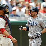 Tampa Bay Rays' Matt Joyce, right, comes home to score on a single by Evan Longoria in the third inning of a baseball game against the Cleveland Indians Sunday, June 2, 2013, in Cleveland. ( …