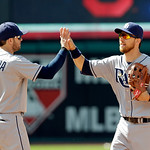 Tampa Bay Rays' Evan Longoria (3) and Ben Zobrist celebrate after a 11-3 win over the Cleveland Indians in a baseball game Sunday, June 2, 2013, in Cleveland. (AP Photo/Mark Duncan)
